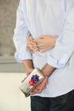 Secretive lan holding present Stock Photo