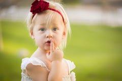 Secretive Little Girl Wearing White Dress In A Grass Field Royalty Free Stock Photography