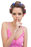 Secretive model with hair curlers Stock Photography