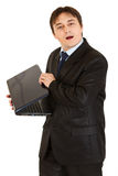 Secretive modern businessman hiding laptops screen Royalty Free Stock Photography