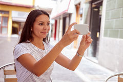 Secretive smiling young girl taking pictures royalty free stock photos