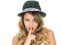 Secretive Young Woman Wearing a Hat Stock Photos