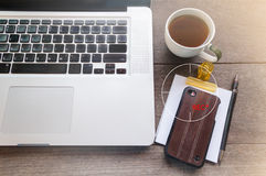 Secretly video streaming moblie phone,cup of coffee and notebook Stock Photography