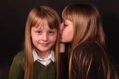 Secreto de la parte de las muchachas Fotos de archivo