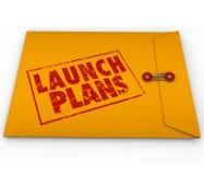 Secretos de la empresa de negocios del comienzo amarillo del sobre de los planes del lanzamiento nuevos Fotografía de archivo