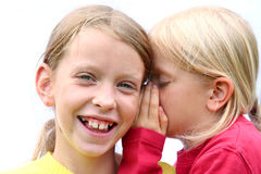 Secrets. One girl giving the other an earful stock image