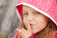 Secrets. Little girl with a secret making shh gesture Royalty Free Stock Image