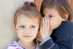 Secrets. Two kids sharing a secret Royalty Free Stock Images