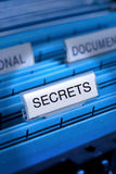 Secrets Secrecy Secret  Files. Files in a filing cabinet with secrets on the main tab Stock Photo