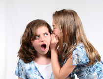 Secrets and Lies. 2 young girls telling secrets Royalty Free Stock Photography