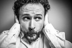 Secrets, man with intense expression, white shirt. Concern for the future, man with intense expression, white shirt, people Royalty Free Stock Images
