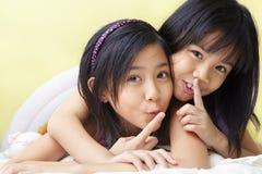 Secrets between sisters stock photos
