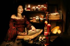 Secrets of sorcery. Young witch studies sorcery Stock Images