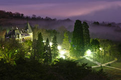 Secrets of times. Old palace in the forest at night Stock Images