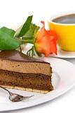Secteur de nougat de chocolat avec le rouge rose et le café Photographie stock