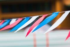 Sectie natte koordvlaggen in rode blauwe en witte kleuren, hangin Royalty-vrije Stock Fotografie