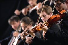 Sectie van de orkest de eerste viool Stock Fotografie