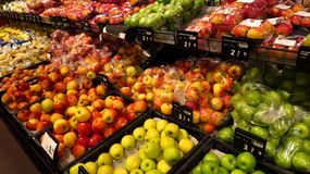 Section With Apples in Supermarket. Section with apples in a modern supermarket Royalty Free Stock Image