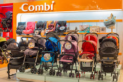 Section of baby carriages Combi in supermarket Siam Paragon. Bangkok, Thailand Royalty Free Stock Image