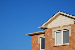 Section of a brick townhouse. With a gabled roof and a window Royalty Free Stock Images