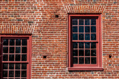 Section of Brick Wall with Two Windows Royalty Free Stock Photos