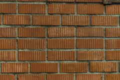 Section du mur avec la vieille maçonnerie de la brique rouge à la ferme photo stock