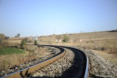 Railway in rural areas. Section of electrified railway in rural areas stock photography