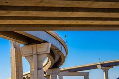 Section of elevated highway with several levels against a bright blue sky.  Royalty Free Stock Images
