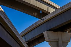 Section of elevated highway with several levels against a bright blue sky in Houston, Texas stock photography