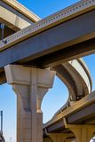 Section of elevated highway with several levels against a bright blue sky in Houston, Texas.  Royalty Free Stock Images