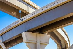 Section of elevated highway with several levels against a bright blue sky. In Houston, Texas Stock Photos