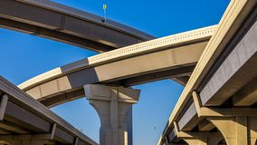 Section of elevated highway with several levels against a bright. Blue sky in Houston, Texas Stock Photos