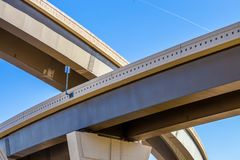 Section of elevated higway with several levels against a bright. Section of elevated highway with several levels against a bright blue sky in Houston, Texas Stock Image