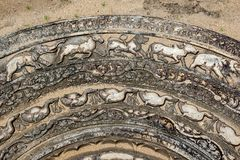 A section of the famous stone moonstone at the ancient ruins of Anuradhapura in Sri Lanka. Moonstones were placed at the entrance to Buddhist temples and Stock Image