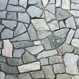 Section of flagstone wall with varying shapes Royalty Free Stock Photo