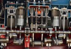 Engine section. Section of a four cylinder engine Stock Image