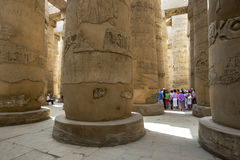 A section of the giant columns known as the Hypostyle Hall within the Karnak Temple (Temple of Amun) in Luxor, Egypt. The hall consisted of 134 columns which Royalty Free Stock Photo