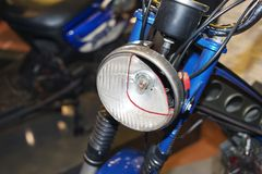 A section of a headlight of a vintage motorcycle Stock Photography