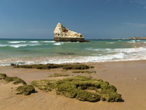 The idyllic Praia de Rocha beach on the Algarve region. Stock Photography