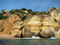 The idyllic Praia de Rocha beach on the Algarve region. Stock Photos
