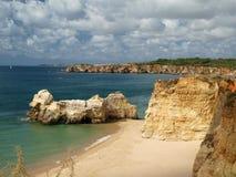 The idyllic Praia de Rocha beach on the Algarve region. Stock Images