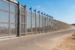 Section of Inner International Border Wall Separating San Diego and Tijuana royalty free stock image