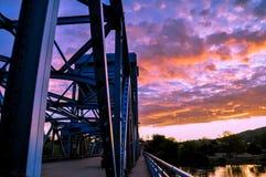 Section of the Lewiston - Clarkston blue bridge against vibrant twilight sky on the border of Idaho and Washington states.  Royalty Free Stock Image