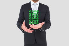 Section médiane d'homme d'affaires avec les icônes médicales Images libres de droits