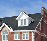 Section of a new house. Against blue sky Royalty Free Stock Images