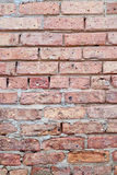 Section of old brick wall. A section of an old brick wall with cracked mortar Stock Photo