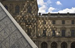 Section and reflection ofLouvre Pyramid. Paris royalty free stock photo