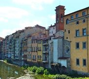 Section of the south bank of the Arno in Florence with old colourful houses facing the river. Section of the south bank of the Arno in Florence with old stock photos