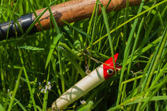 Section of spinning and tackle in greeen grass Stock Photography