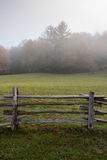 Section of Split Rail Fence and Foggy Field Royalty Free Stock Image